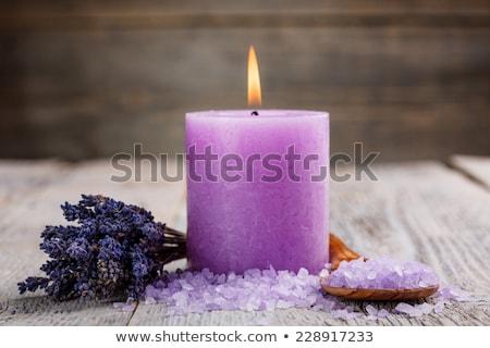 close up burning purple candle stock photo © janssenkruseproducti