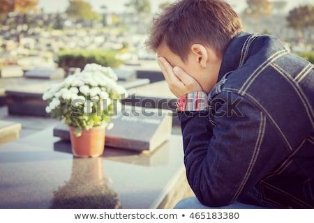 Boy crying at tombstone alone Stock photo © bluering