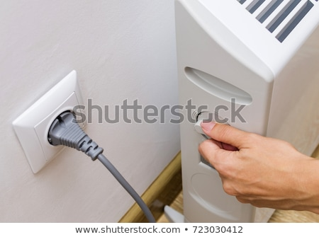 Woman's Hand Adjusting Thermostat Valve Stock photo © AndreyPopov