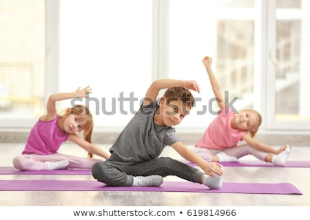 Kids doing gymnastic exercises on the floor Stock photo © ilona75