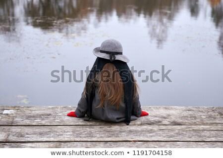 Child sitting alone on dock  Stock photo © jarenwicklund