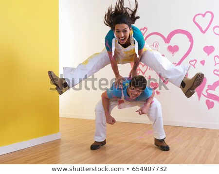 Girl leap frogs over man. Stock photo © IS2