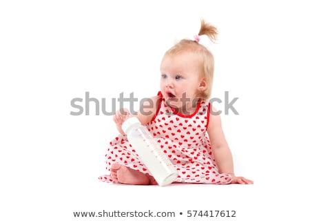cute beauty baby girl in red dress hold milk bottle Stock photo © Traimak
