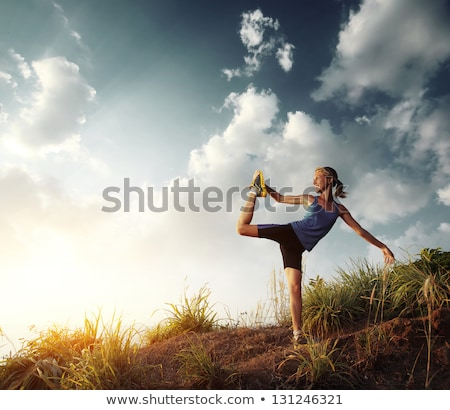 woman stretching in walkway Stock photo © IS2