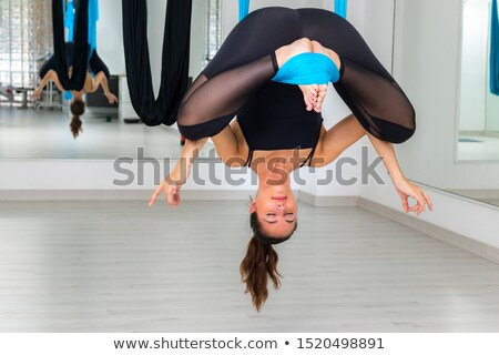 woman relaxing in a swing eyes closed Stock photo © IS2