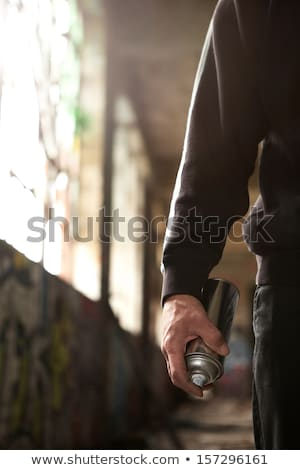 Black Teenager doing graffiti on a wall Stock photo © IS2