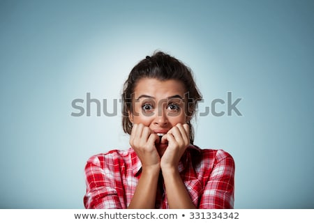 Close up portrait of confused caucasian woman looking on camera  Stock photo © deandrobot