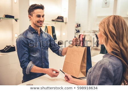 Beautiful young female shopper in a clothing store Stock photo © lightpoet