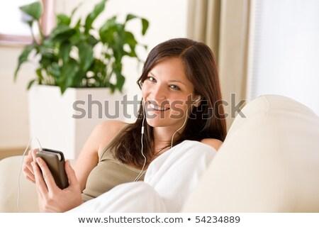 vrouw · luisteren · mp3-speler · zon · fitness · hoofdtelefoon - stockfoto © is2
