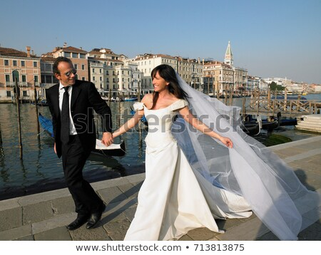 Bride and groom walking. Grand Canal Stock photo © IS2