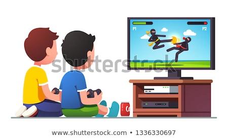 Iki çocuklar erkek oynamak video oyunu vektör Stok fotoğraf © pikepicture