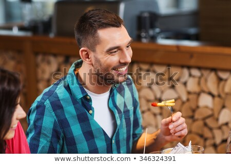Happy Friends Sitting in Cafe Eating French Fries Stock photo © robuart