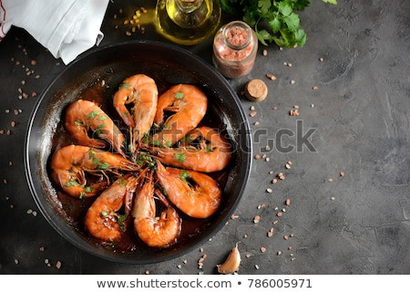 Shrimps roasted on frying cast iron pan Stock photo © Melnyk