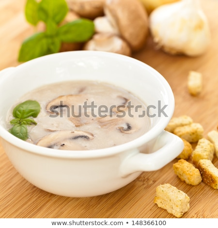 creamy mushroom soup with fresh herbs garlic croutons stock photo © peteer