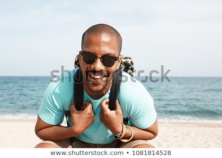 image of happy african american people wearing backpacks sitting stock photo © deandrobot