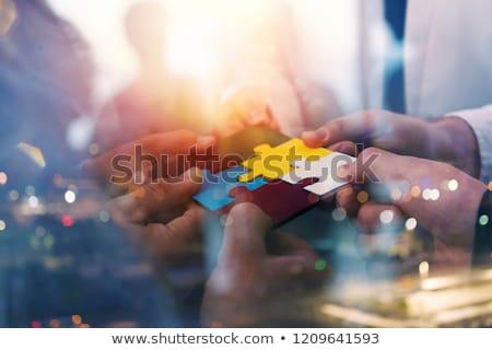 gente · de · negocios · piezas · del · rompecabezas · trabajo · en · equipo · doble · exposición - foto stock © alphaspirit