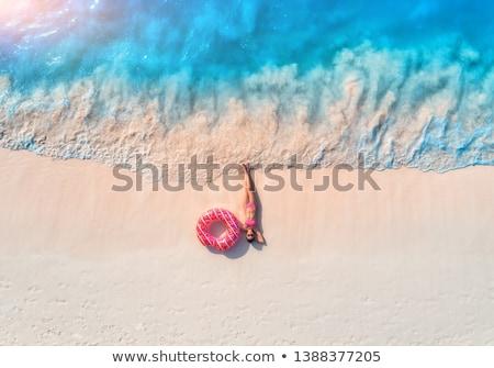 Légifelvétel nő úszás gyűrű homokos tengerpart gyönyörű Stock fotó © denbelitsky