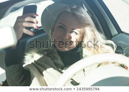 Jonge vrouw bestuurder mobiele telefoon auto stad Stockfoto © Giulio_Fornasar