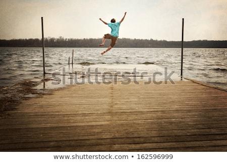 giovane · jumping · lago · acqua · uomo · felice - foto d'archivio © jossdiim