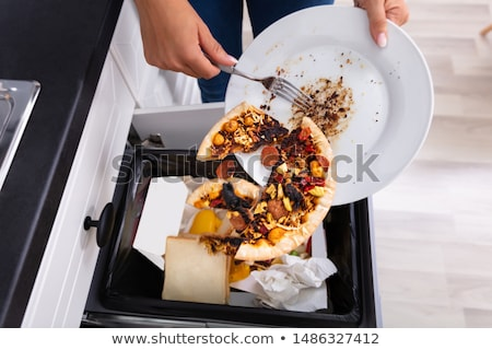 Person Throwing Pepperoni Pizza In Dustbin Stock photo © AndreyPopov