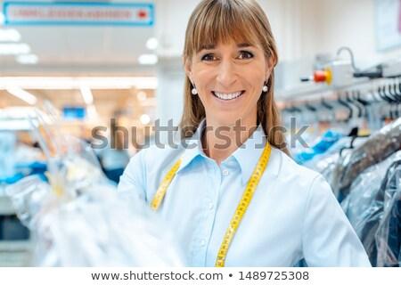 Empregado mulher têxtil limpador trabalhar Foto stock © Kzenon