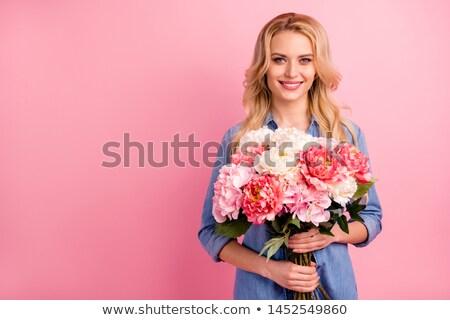 Güzel kız gülen çiçek el Stok fotoğraf © lichtmeister