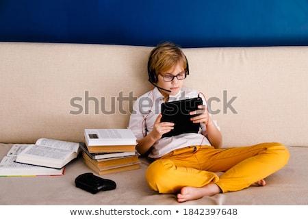 Chłopca słuchawki podręcznik nauki domu edukacji Zdjęcia stock © dolgachov