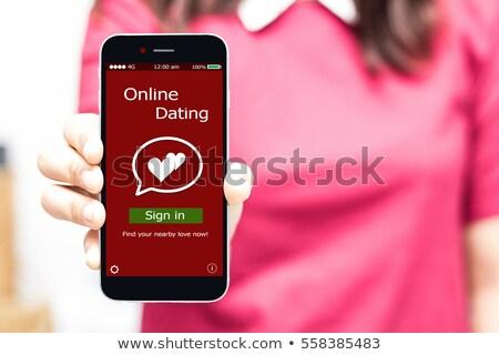 женщину мобильного телефона романтика жульничество применение Сток-фото © AndreyPopov