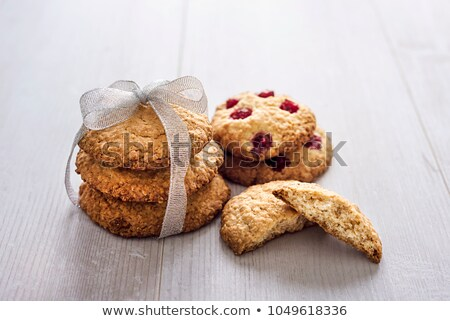 Fresh baked oat cookies closeup on rustic wooden table. Stock photo © marylooo