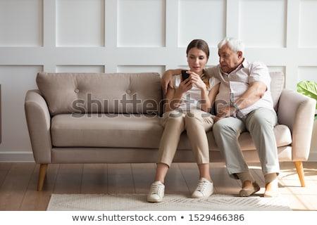 Woman helping older ones Stock photo © jossdiim