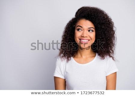 Imagen agradable alegre mujer sonriente mirando aislado Foto stock © deandrobot