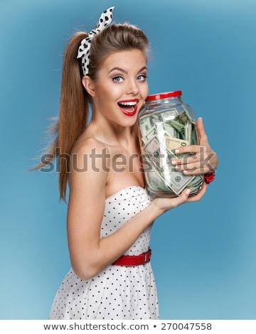 Donna conto bella donna monete Foto d'archivio © piedmontphoto