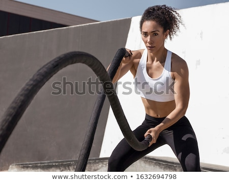 Woman exercising at the gym Stock photo © photography33