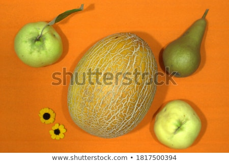 the autumn flowers and orange melon stock photo © traven
