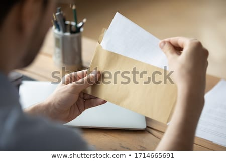 Successful Postal or delivery service concept. Man holding cardb Stock photo © HASLOO