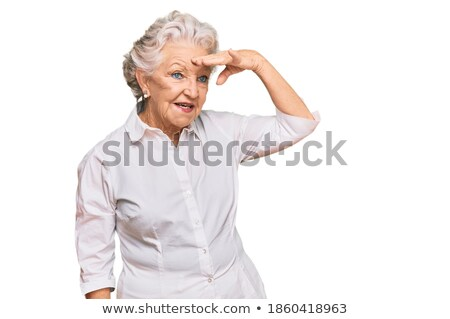 Elderly woman staring into the distance Stock photo © photography33