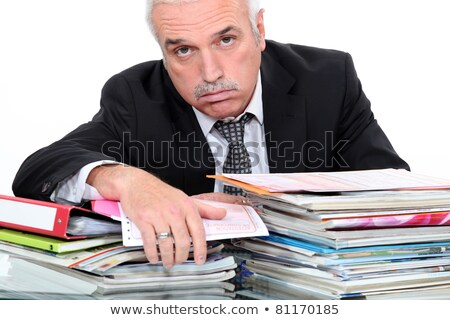 Grey hairy man looking fed up in front of paper work Stock photo © photography33