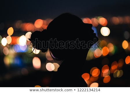 Woman looking at wallpaper Stock photo © photography33