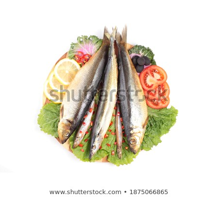 pickled herring with tomato rings stock photo © shutswis