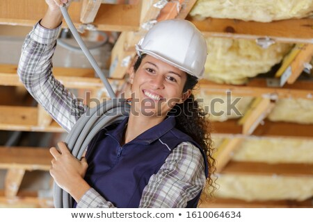 woman covering an electrical wire stock photo © photography33