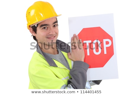 young bricklayer wearing safety jacket and stop sign Stock photo © photography33