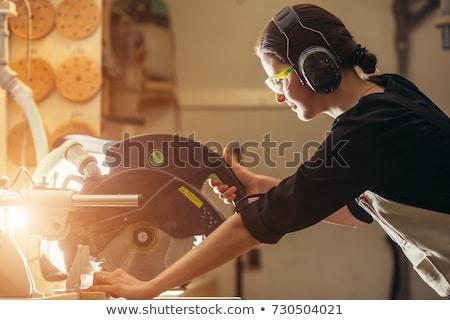 Stock fotó: Női · ács · fűrész · munka · szemüveg · munkás