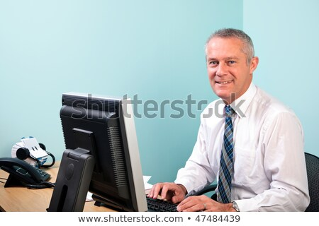 Mature businessman sat at desk Stock photo © photography33