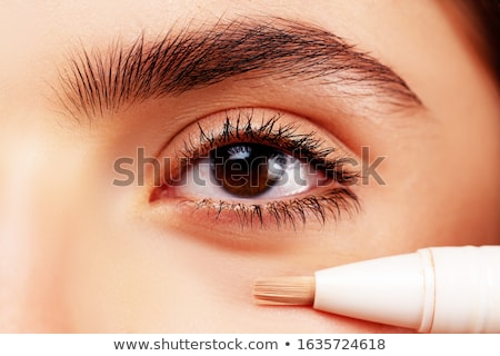 Woman applying concealer Stock photo © photography33