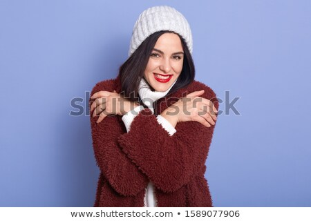 The young woman in a black coat and a fur cap. Isolated on white Stock photo © acidgrey