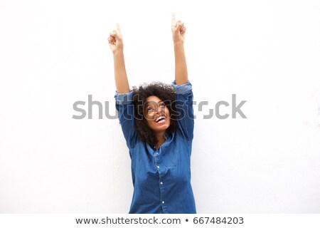 gülen · güzel · bir · kadın · işaret · yukarı · fotoğraf · mutlu - stok fotoğraf © wavebreak_media
