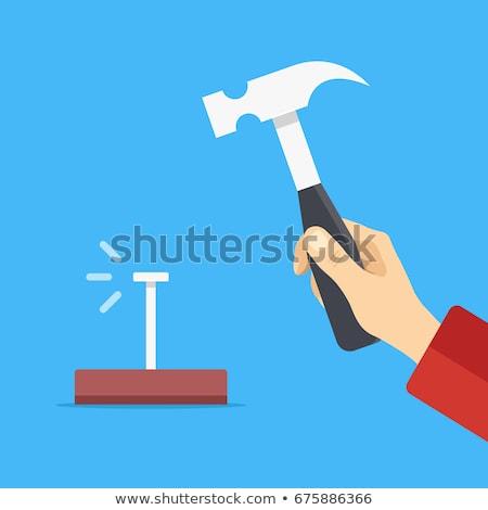 cartoon hand   holding metal nail  vector illustration stock photo © indiwarm