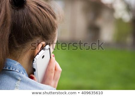 Nő hív telefon ősz park mosoly Stock fotó © Andersonrise