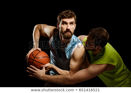 basket player young man over blue stock photo © lunamarina