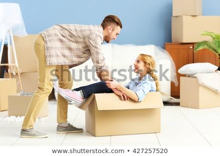 fiatalember · nő · hordoz · kartondoboz · fehér · boldog - stock fotó © elnur